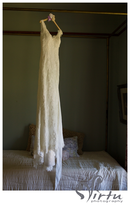 wedding dress hanging off bed at barr mansion austin texas