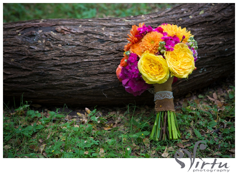 wedding bouquet leaning on log